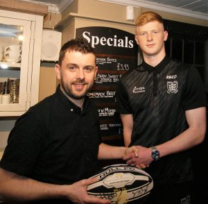 Allen with Hull FC academy player, Harvey Barron, who the pub is sponsoring