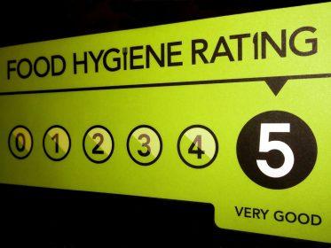 A 5 hygiene rating sticker on a door