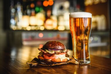 Burger and pint in a pub